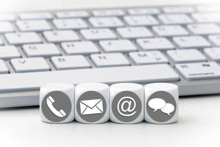 Website and Internet contact us page concept with colored icons on cubes Stock fotó