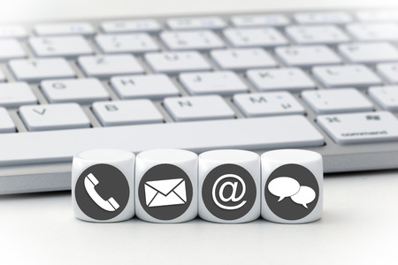 contacting: Website and Internet contact us page concept with colored icons on cubes Stock Photo
