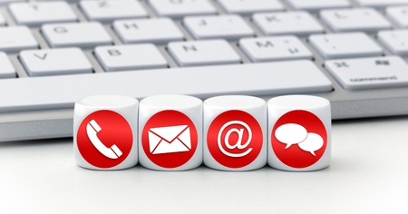 Website and Internet contact us page concept with red icons on cubes on a keyboard