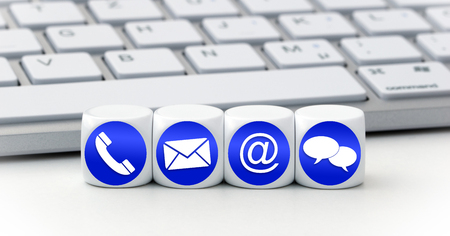 Website and Internet contact us page concept with blue icons on cubes on a keyboard