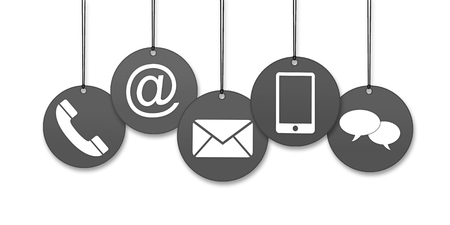 Website and Internet contact us page concept with icons on four black hanged tags on white background
