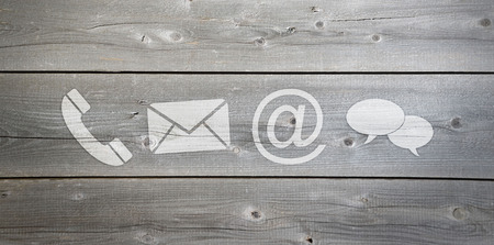 Wood background design with white contact icons Standard-Bild