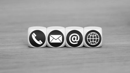 Black and white internet contact us icons on cubes