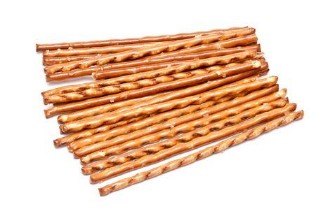 pretzel stick: many salted sticks over a white background Stock Photo