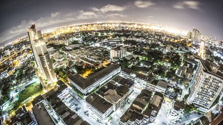 eye: Fish eye from rooftop over Bangkok city night skyline