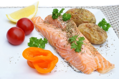 Steamed salmon fillets with potatoes and vegetables photo