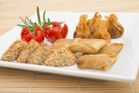 sours: oriental party selection, prawn toasts, vegetable parcels, sweet and sours chicken wontons Stock Photo