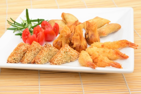 oriental party selection, king prawns, prawn toasts, vegetable parcels, sweet and sours chicken wontons photo
