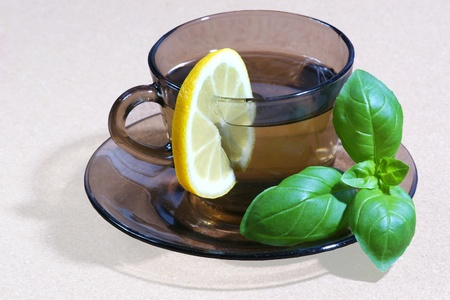 Mint tea with slice of lemon close up photo