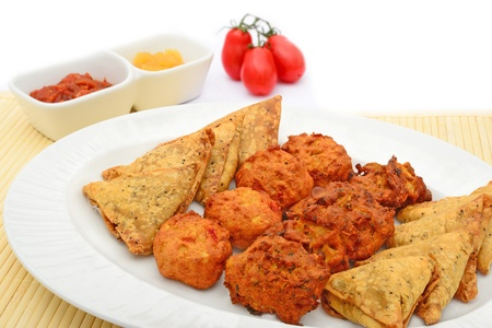 Indian snack selection and tomatoes photo