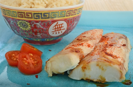 grilled chinese oriental style  fish with rice and tomato photo