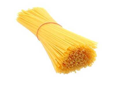 Dry uncooked spaghetti isolated on white background photo