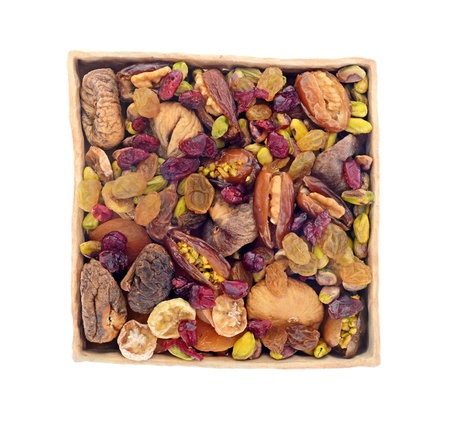 dry fruit and nuts in ceramic tray isolated on white background photo