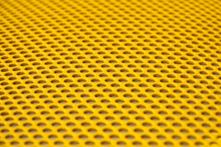 Yellow metal grille from gym equipment