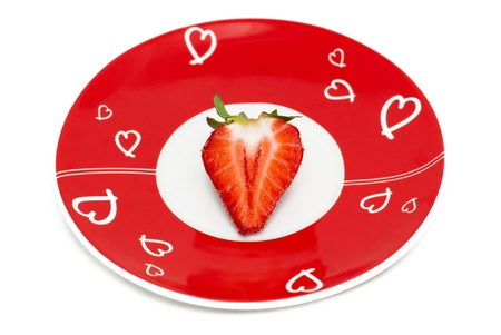 deliciously: Deliciously half a red strawberry on the romantic red plate