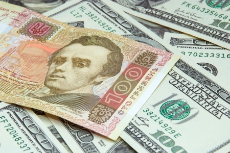 One hundred gryvnas on dollars background Stock Photo