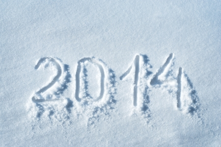 2014 written in snow, new year concept photo
