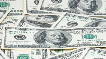 money background: Many hundred dollar banknotes make money background