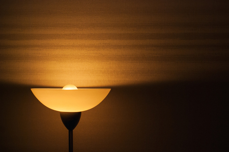 lampshade: Lampshade and light from the lamp on the wallpaper