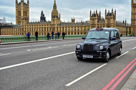 taxi famous building: House of Parliament in London Editorial