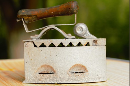 bric: Old clothes iron, work with coals Stock Photo