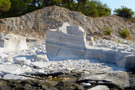 exportation: Aliki. From the archaic period until the Byzantine era, Aliki was one of the main Greek areas regarding the mining and exportation of marble. Nowadays, we can still trace the results of the ancient mining techniques through the sculptured rocks of the are Stock Photo