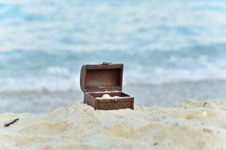 Treasure chests in the sand on the seashore Archivio Fotografico