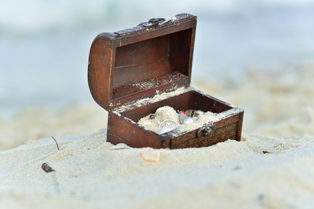 Treasure chests in the sand on the seashore Stock Photo