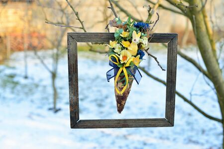 3d picture in nature. Dried flowers in a very old photo frame, hanging in a tree Stock Photo