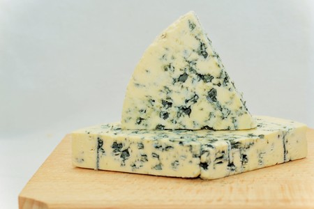 penicillium: Blue cheese is a general classification of cheeses that have had cultures of the mold Penicillium added so that the final product is spotted or veined throughout with blue