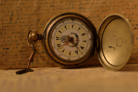 old letters: Old pocket watch with key and old letters background Stock Photo