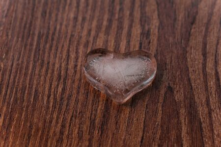insensitive: Heart of ice on brown background Stock Photo