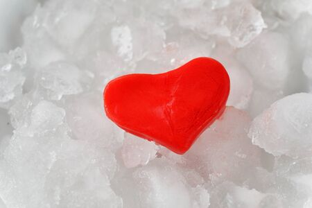insensitive: Red heart of ice on ice background