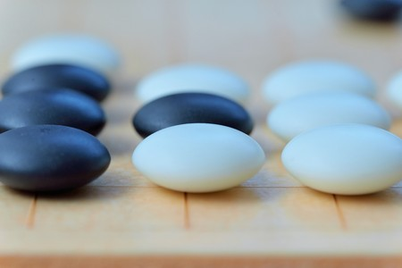 GO game. GO is an abstract strategy board game for two players, in which the aim is to surround more territory than the opponent.