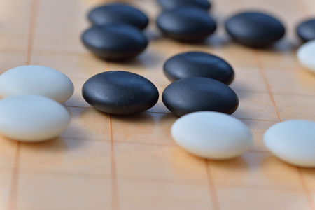 differentiation: GO game. GO is an abstract strategy board game for two players, in which the aim is to surround more territory than the opponent.