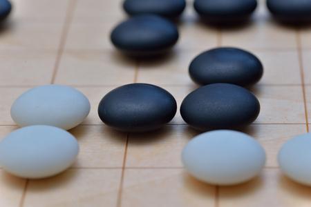 ゲーム行きます。移動は、2 プレーヤーの目的は、対戦相手より多くの領土を囲む、ため抽象的な戦略ボードゲームです。 写真素材