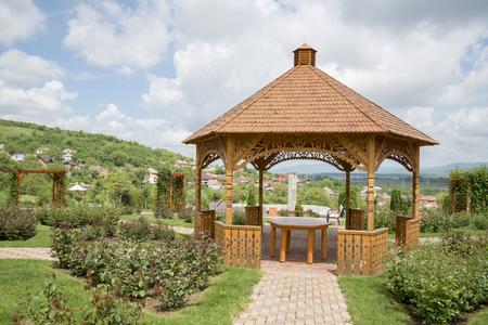 Wooden gazebo in a garden