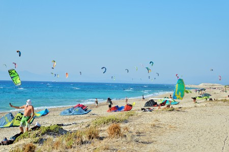 Kiteboarding in Agios Nikita Beach, Lefkada Island,Greece, August 25, 2017,  a beach full of people practicing kiteboarding