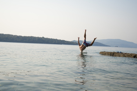 A man jumping into the water Stock Photo