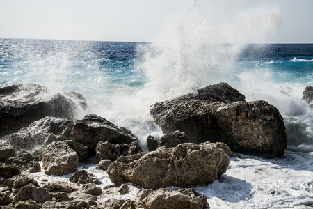 Enormous waves crashing on the shore and on the rocks at the Megali Petra Beach at the sunset, Lefkada Island, Greece Stock Photo