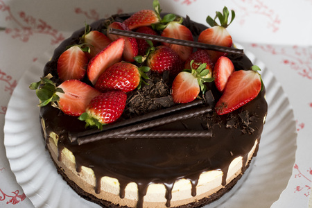 This triple chocolate mousse cake is rich, chocolaty and decadent, hard not to fall in love with it from the first bite. Three airy layers of chocolate goodness on top of an oreo crust, is simply hard to resist Stock Photo