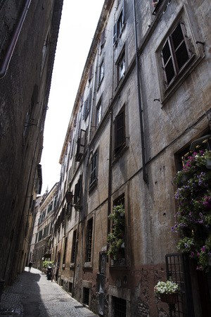 A very narrow street in Rome, the sky is hard to see