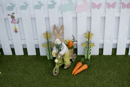 Easter decoration for photo sessions, rabbits in the garden 写真素材 - 120371091