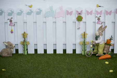 Easter decoration for photo sessions, rabbits in the garden 写真素材 - 120371092