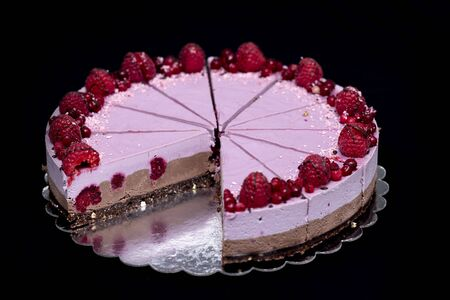 Raw vegan cake with chocolate and raspberries, a healthy and tasty dessert, sugar-free, gluten-free