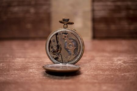 The mechanisms of a very old pocket watch from 1900 写真素材