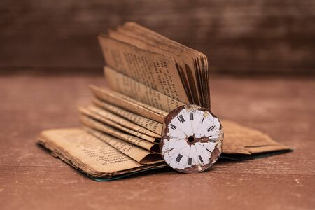 A book over a hundred years old and a watch from 1850 写真素材