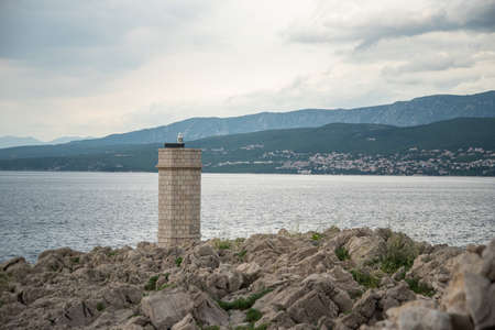 Silo lighthouse in Punta Silo (Å¡ilo), Kvarner bay on Krk island, Croatia and the view of Crikvenica