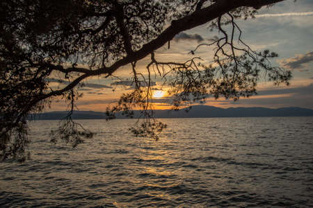 Sunset in Malinska, a settlement in the northwestern part of the island Krk in Croatia and an important tourist town. It lies on the coast of the Adriatic Sea
