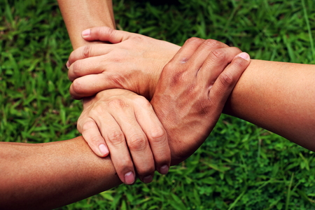 Human hand. Peoples hands together. Stock Photo